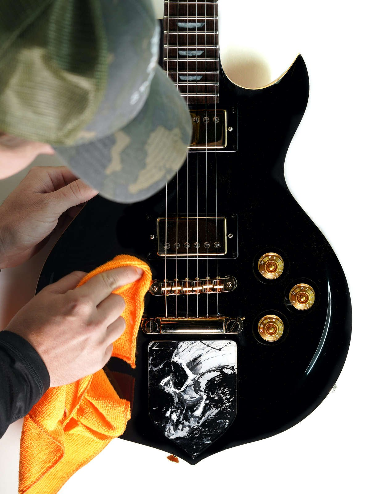 A guitar being polished