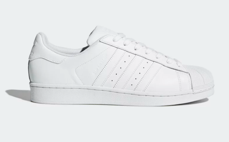 side view of white adidas superstar