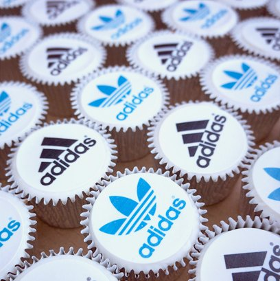 Corporate cupcakes with logo toppers