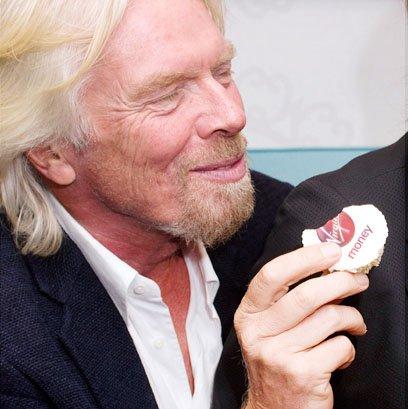 Richard Branson with Virgin Money logo cupcakes