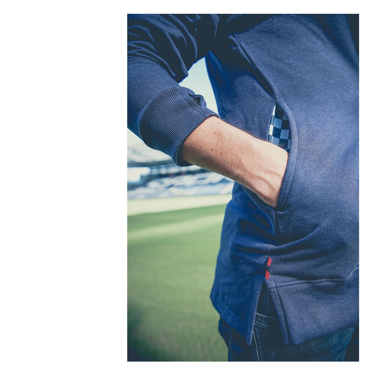 hidden pockets on the navy sweatshirt for SKCxLBF