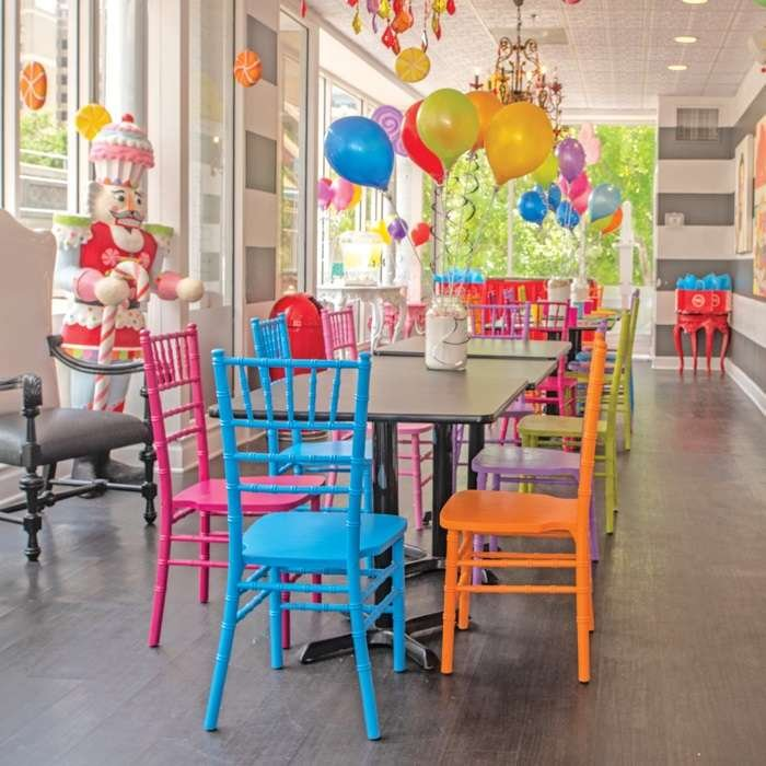 tables with colored chairs