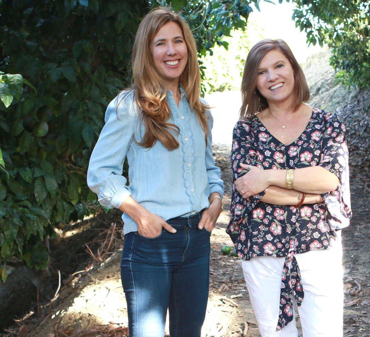 AVOILA Founders Kristy Hunston Grace OSullivan standing on path in avocado farm.