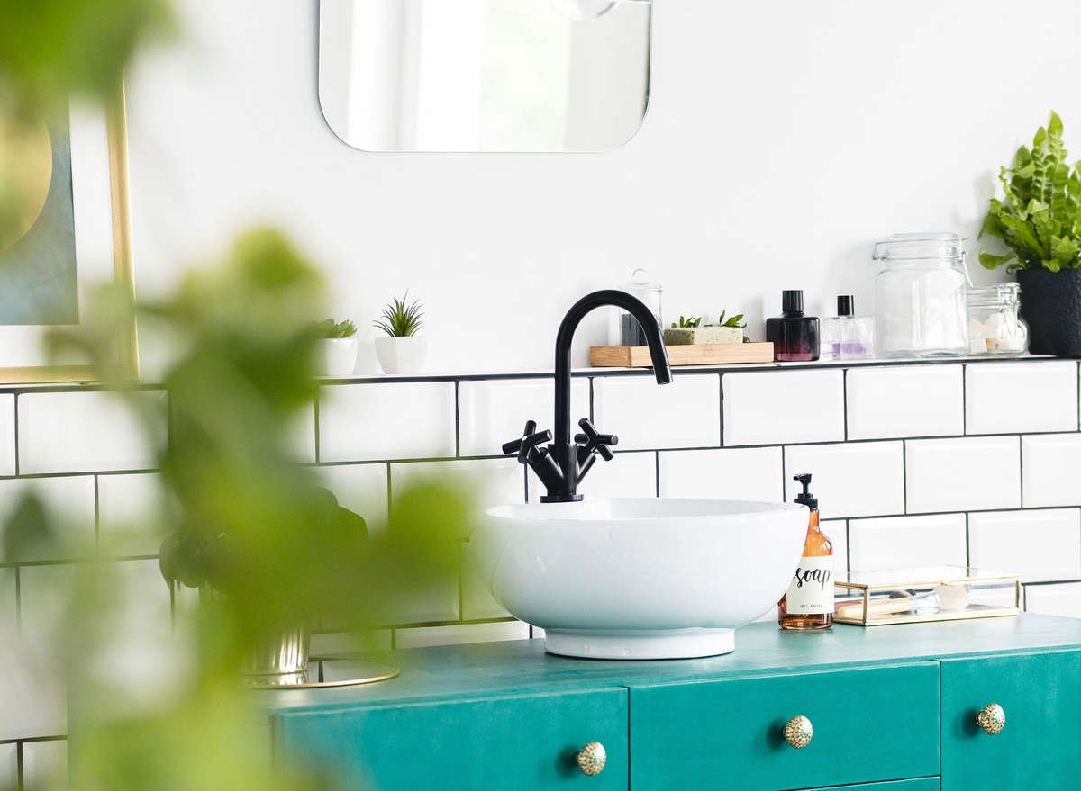 Clean beauty bathroom sink with green plants AVOILA