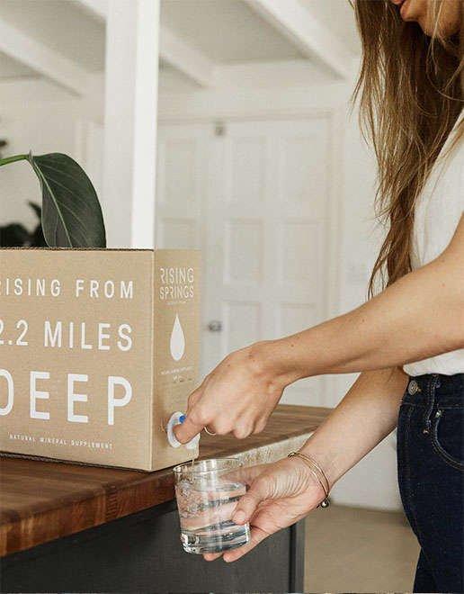 Girl enjoying water from wellness box