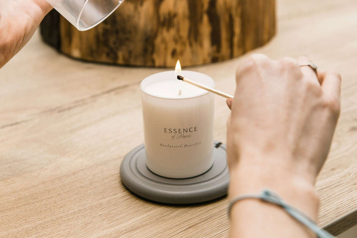 Candle burning on a heat-proof marble tray