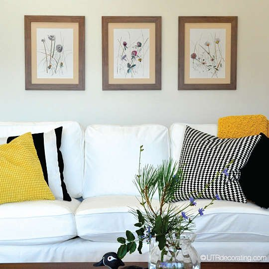 How to hang 3 pictures above a couch