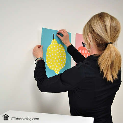 Hang posters without putting holes in your walls