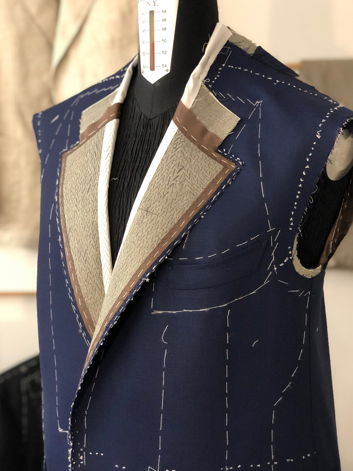 Sartoria Sciarra, bespoke suit, bespoke jacket in progress, hand made tailoring, bespoke tailoring, artisan craftsmanship, hand pad stitched lapels, Italian camel hair canvas, Loro Piana Zelander high twist wool fabric, luxury bespoke, luxury tailoring, barchetta out breast pocket,