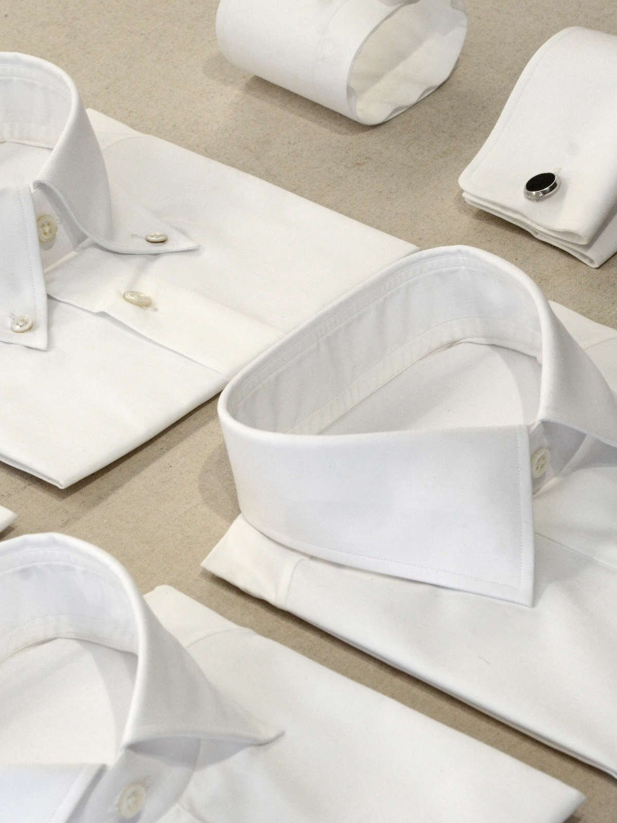 Bespoke shirts, Australian mother of pearl buttons, Italian cotton shirt, luxury shirt, luxury bespoke, white shirts, bespoke shirt collars, bespoke shirt cuffs, shirt collars, shirt cuffs, a range of white shirts collars and cuffs