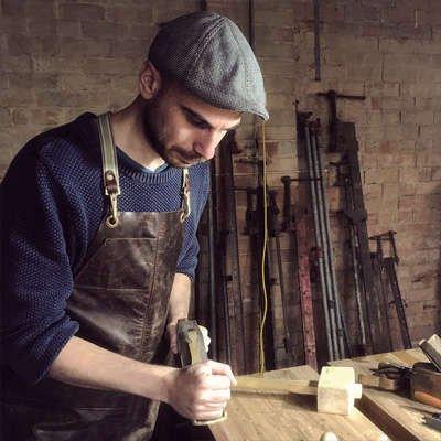 Whiskey + Wood - James Pateras in workshop using plane