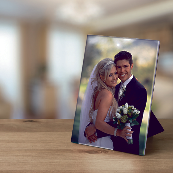 metal photo of bride and groom facing forward with arms around each other