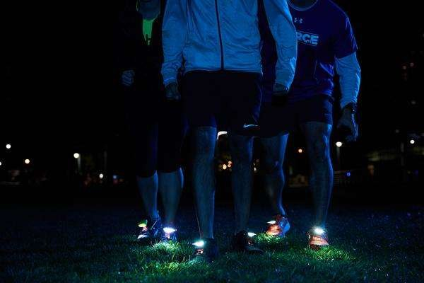 Group wearing running Shoe Lights by Night Tech Gear