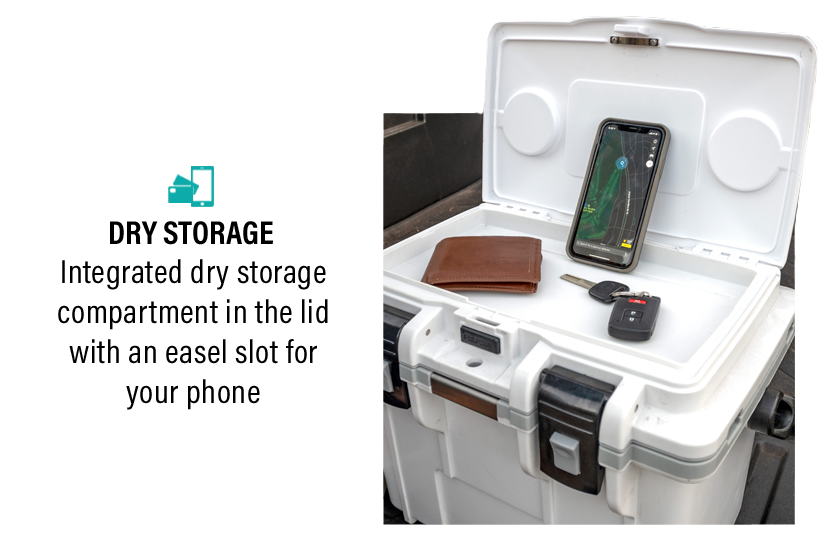 The open dry box of the 14QT Personal Cooler & Dry Box with personal effects inside and a cellphone propped up in the easel slot.