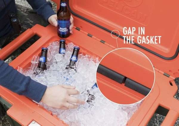 A person pulls a beer out of a cooler. An inset image shows the gap in the gasket of the cooler, which is there by design.