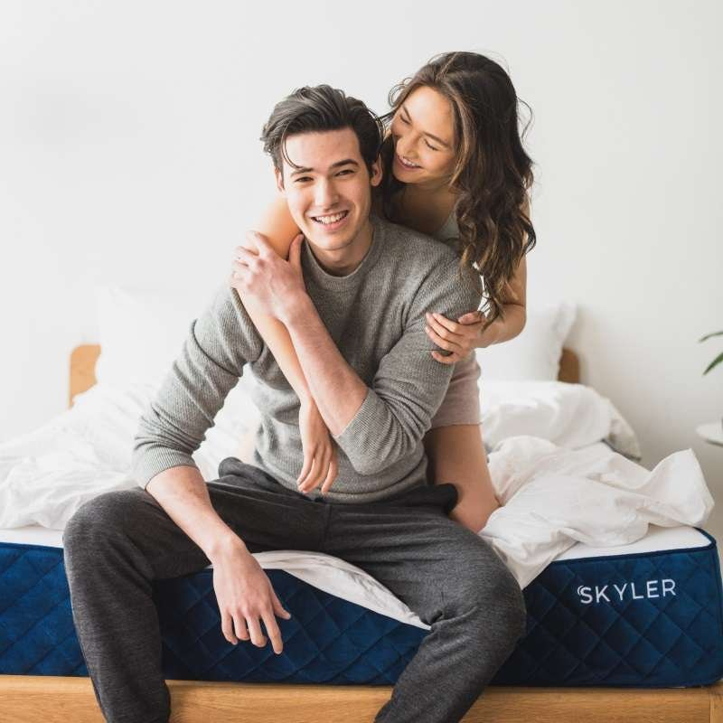 Couple hugging on the Skyler mattress