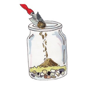 adding soil to a terrarium jar