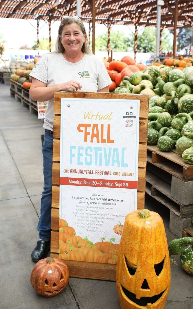 Julie Barbour with Fall Fest sign and ceramic pumpkins