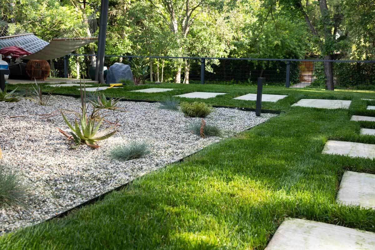 Studio Plumb backyard sod and stepping stones
