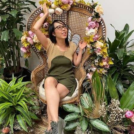 Lani Love surrounded by plants