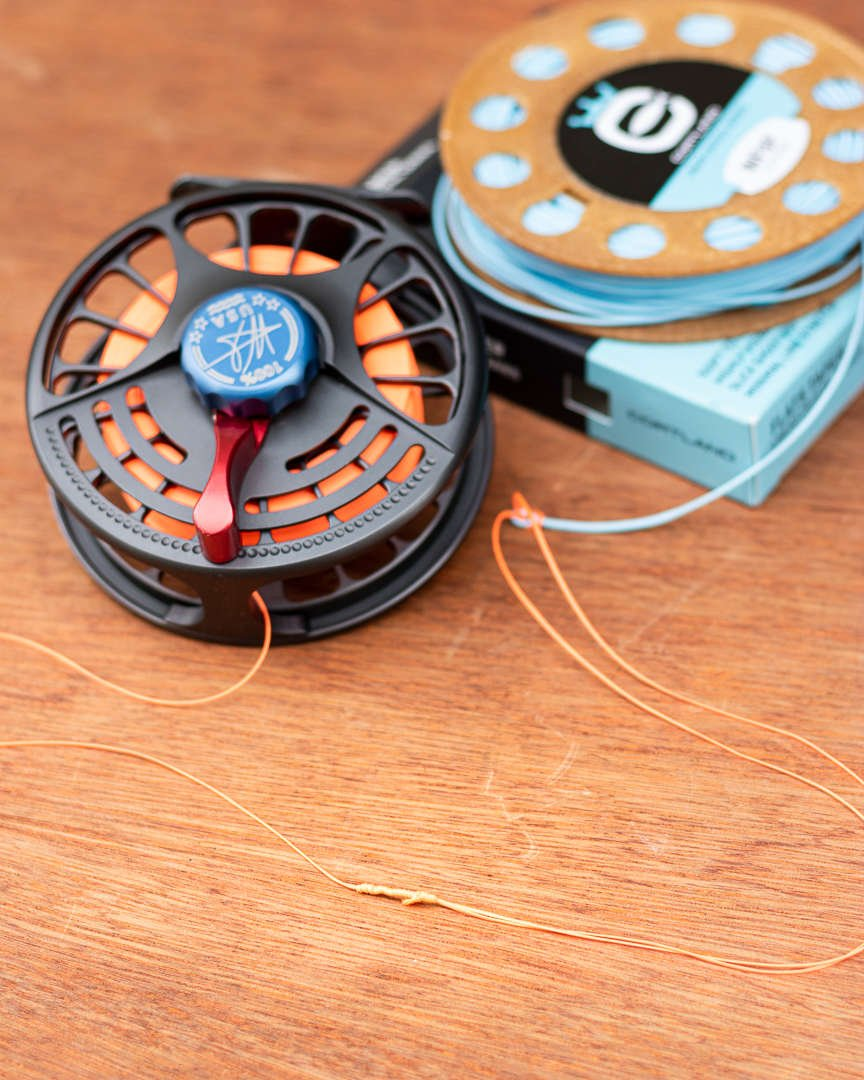 Fly fishing reels backing connected to fly line.