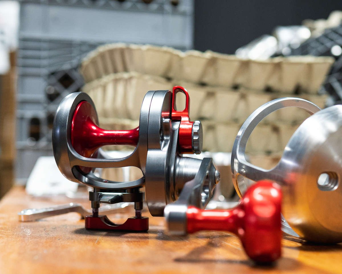 Red Fishing Reel next to raw material.