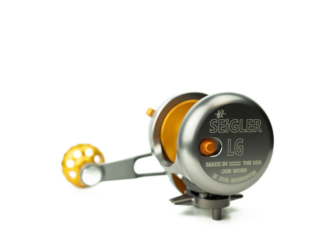 seigler custom fishing reel with orange accents.