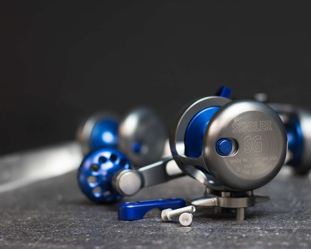 Blue fishing reel on tray.