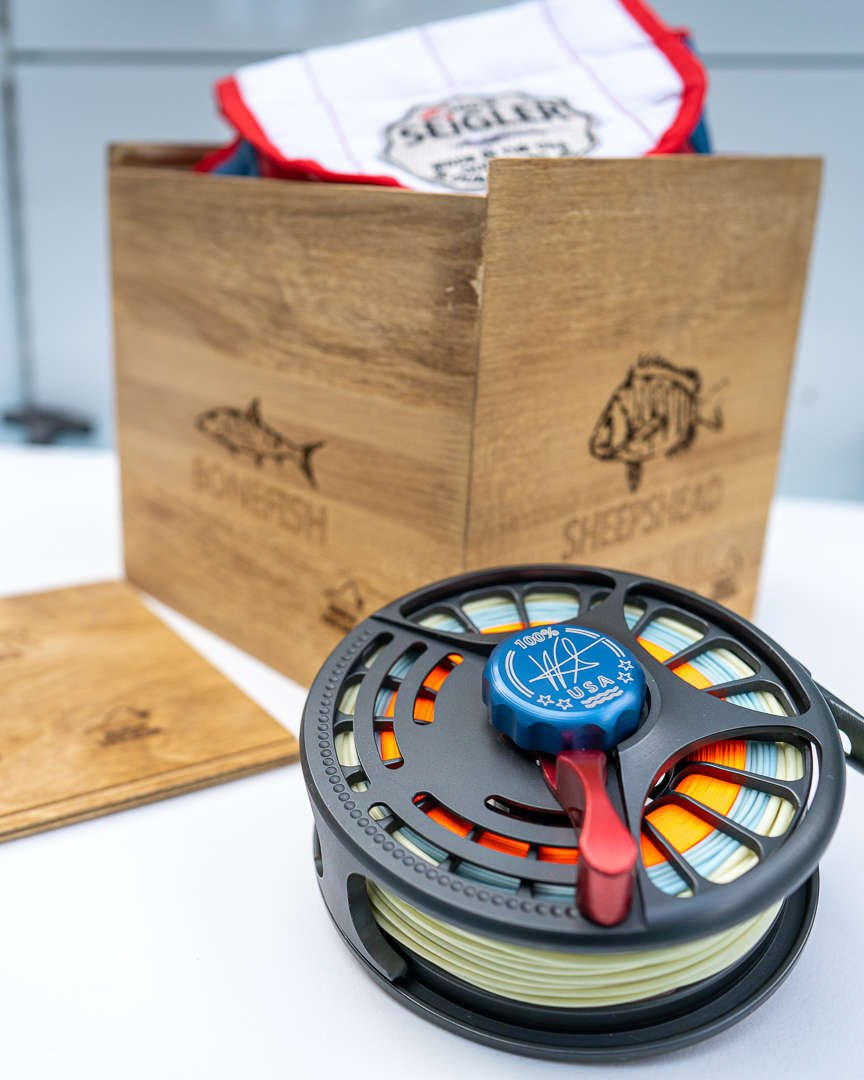 Seigler fly reel on boat with box.