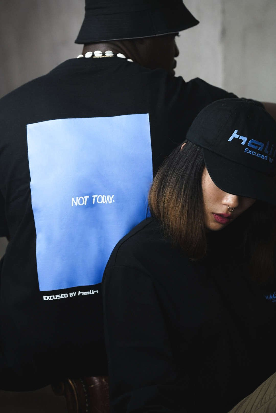 Female and male model wearing Halin Worldwide streetwear look from the Not Today collection part 3