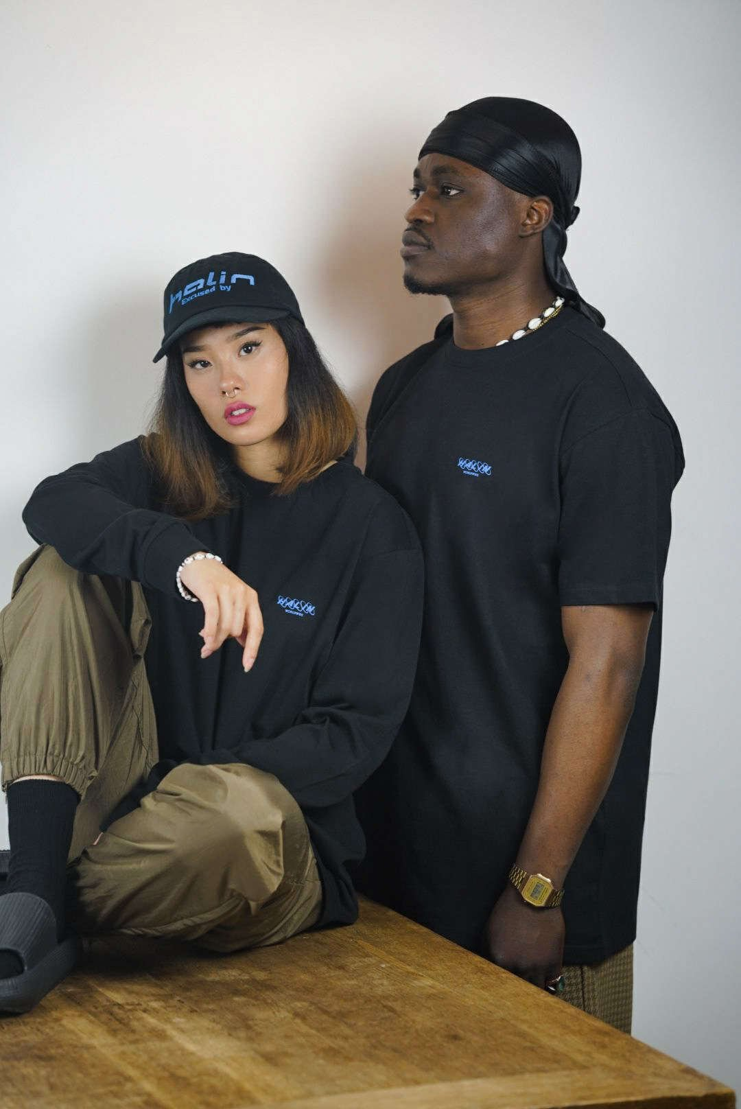 Female and male model wearing Halin Worldwide streetwear look part two from the Not Today collection.