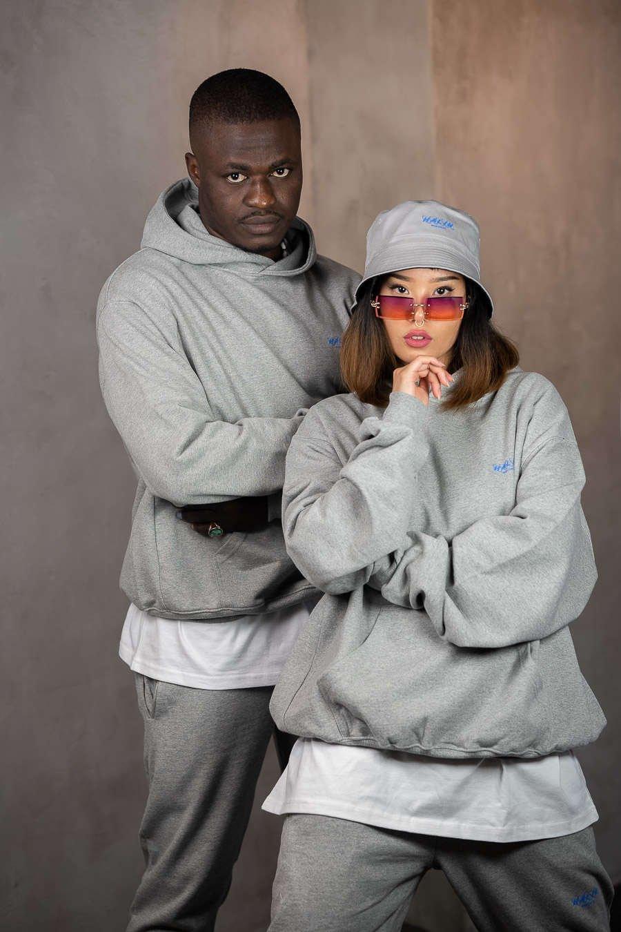 Female streetwear model wearing reversible bucket hat and grey oversize hoodie from Halin.