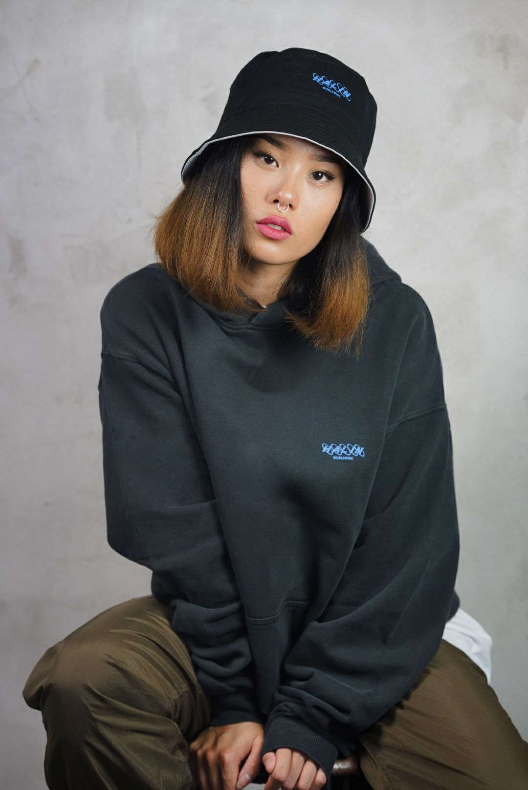 Female streetwear model wearing Halin Oversize Hoode Around the world from the drop Not Today part two.