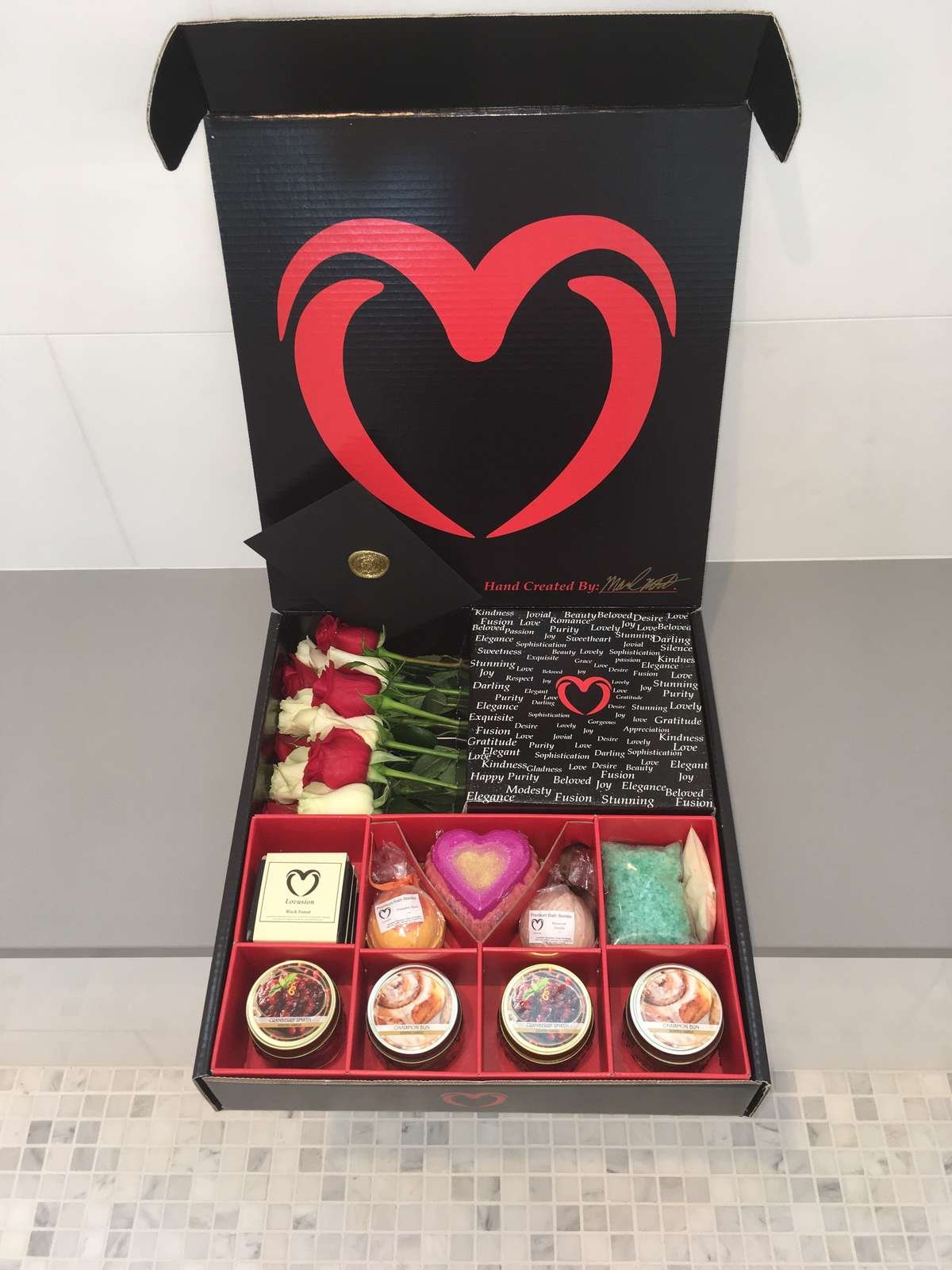Lovusion black box, dozen roses, bath bombs, candles, romantic gift