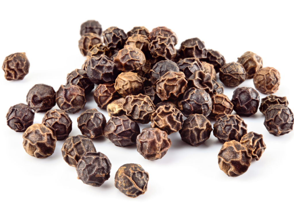 Black peppercorns on a white background.