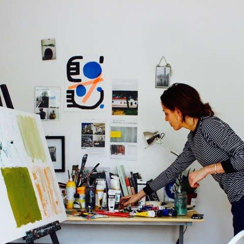 Lu Prints painting in her studio