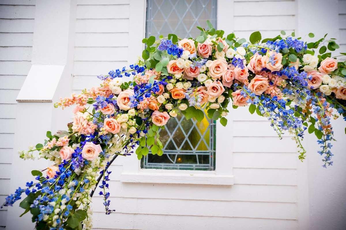 Tiffany rose, flower moxie, peach rose, peach and blue wedding, peach arch, delphinium arch, circle arch