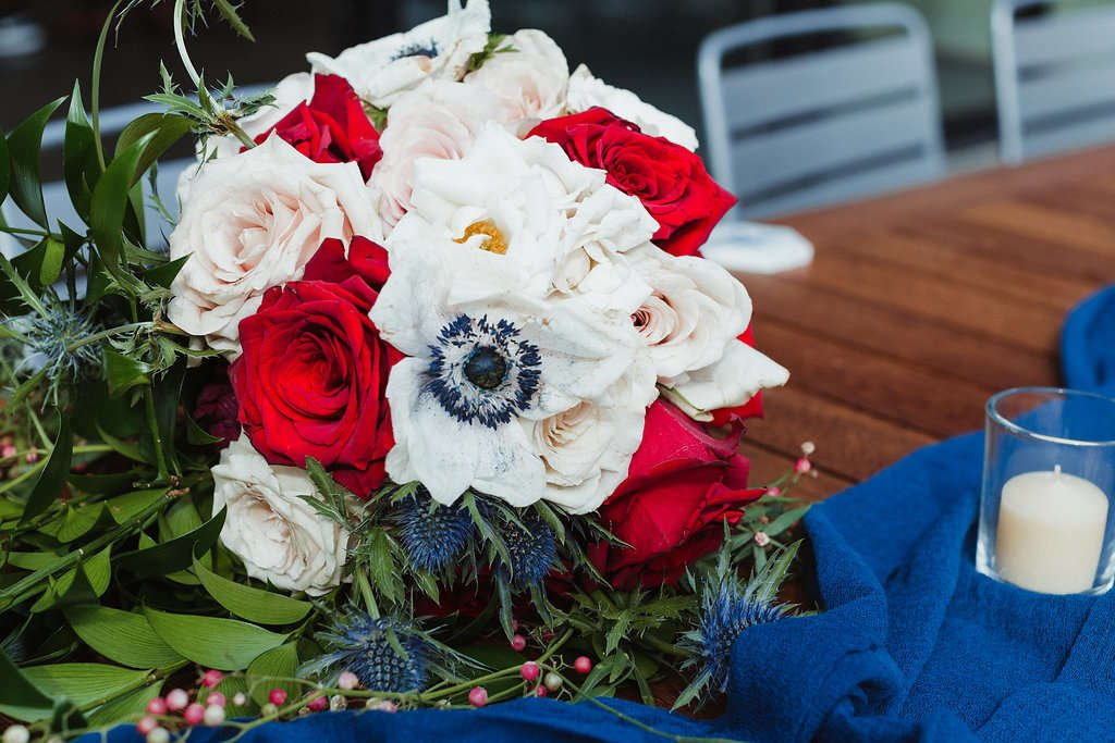 You can DIY your own wedding flowers! diy bride, flower moxie, diy flowers, budget bride, diy wedding, white anemones, bridal bouquet, thistle, quicksand roses, red roses, freedom roses, cream spray roses