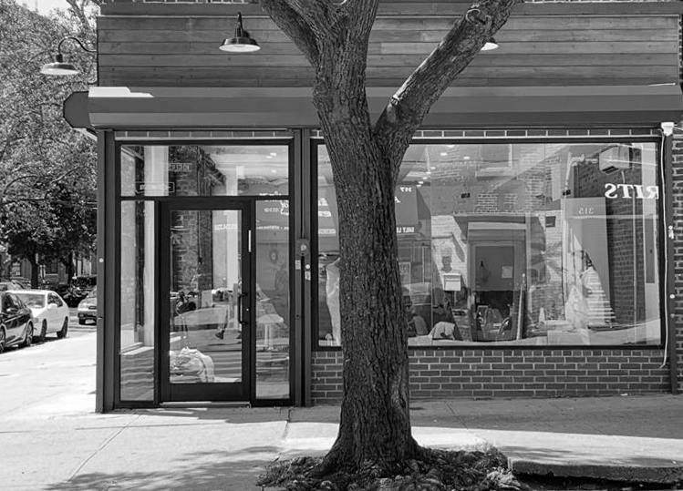 black and white photo of corner shop