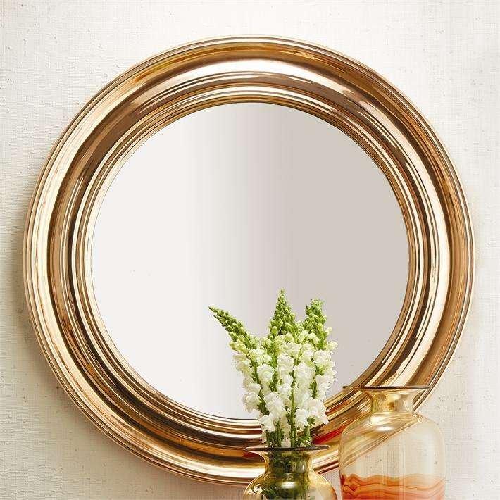 round metallic mirror