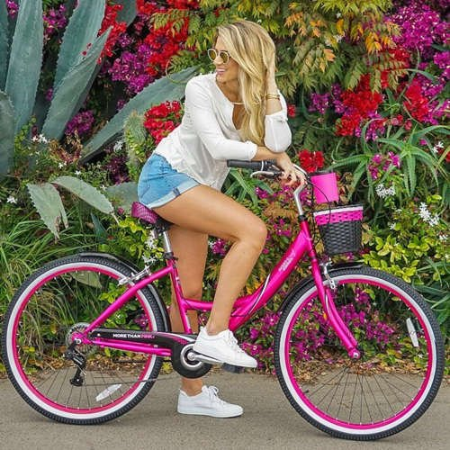Woman on a Susan G. Komen Pink Cruiser with a floral background