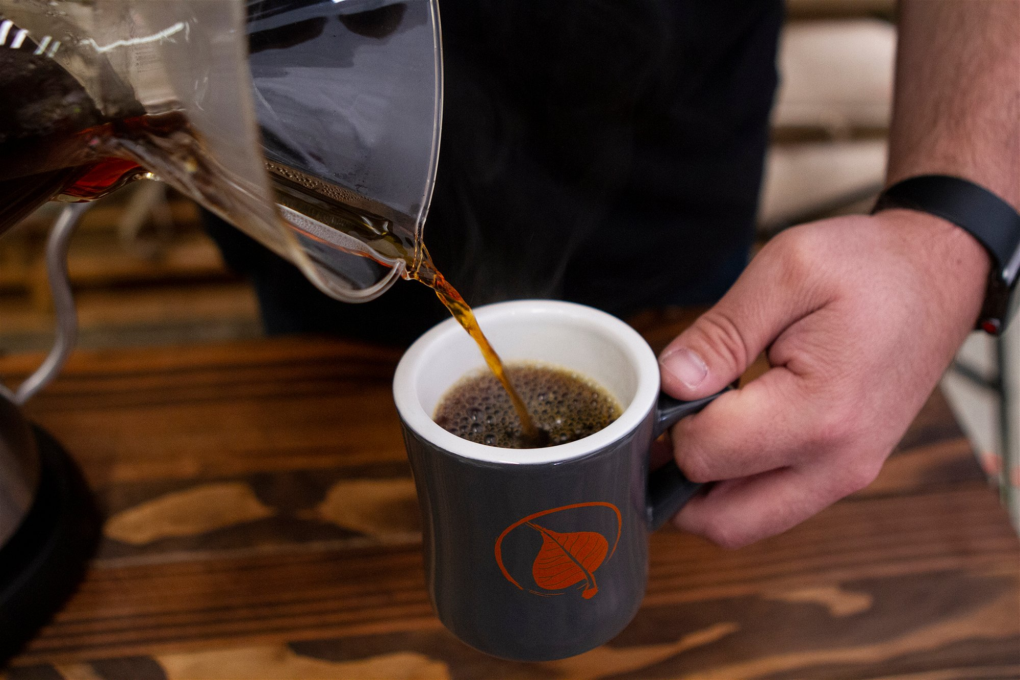 POURING COFFEE FROM CHEMEX INTO MUG