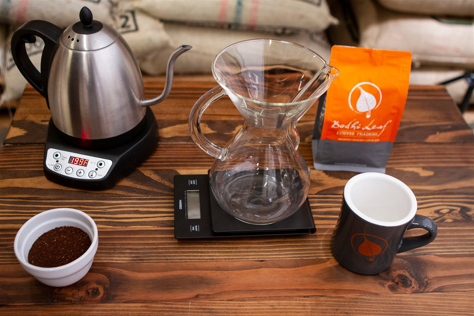 CHEMEX ON SCALE WITH MUG, KETTLE, AND COFFEE