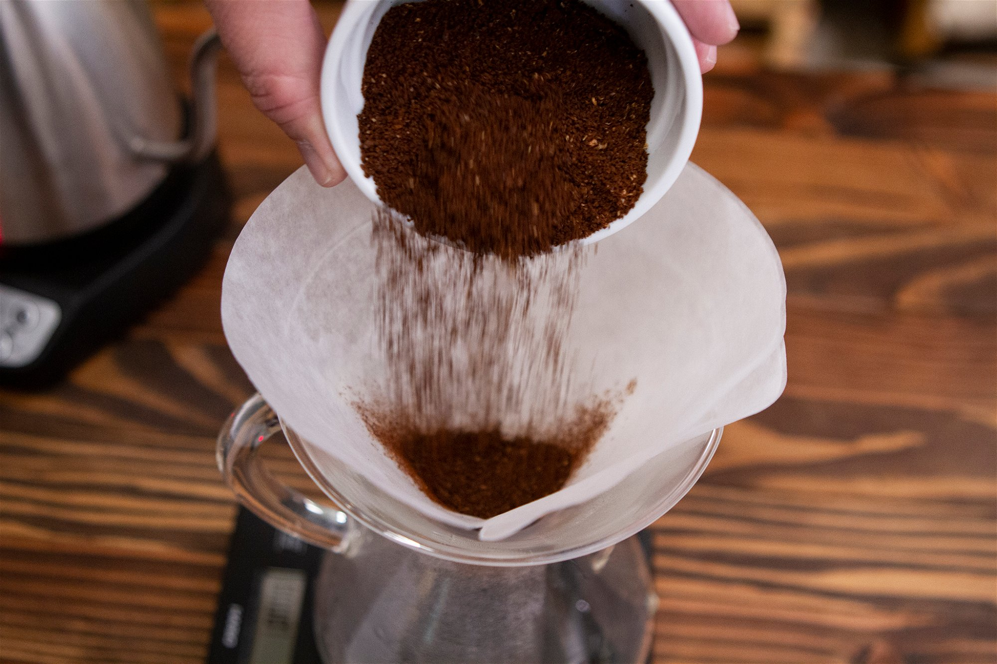 COFFEE GROUNDS POURING INTO CHEMEX