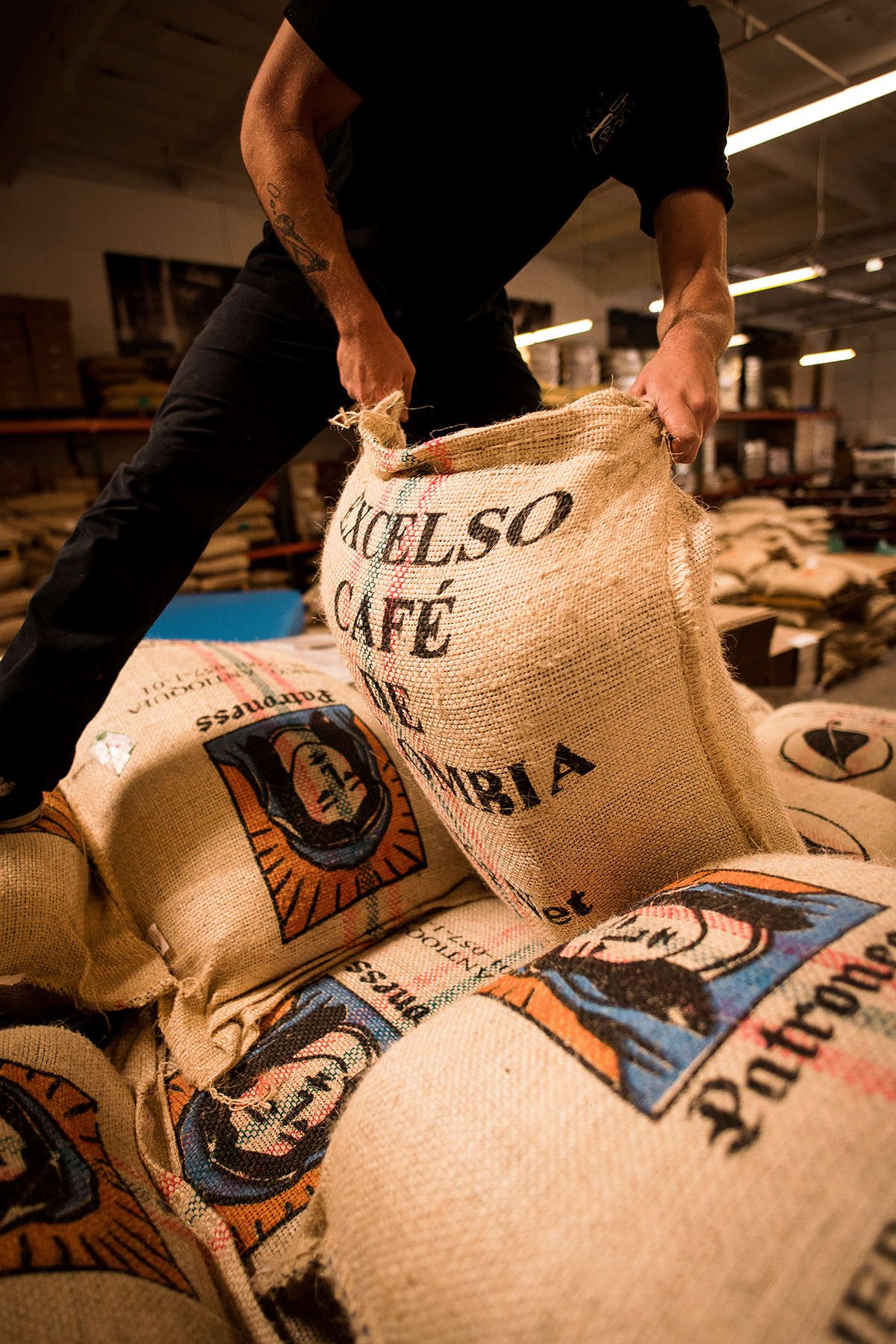 Warhouse Worker Moving Coffee Bags