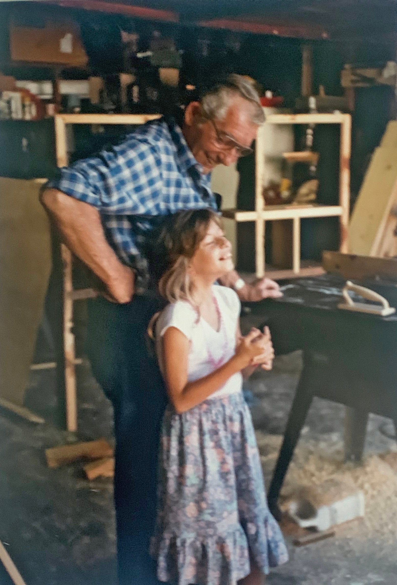 Lisa and her grandfather in their garage/woodworking shop