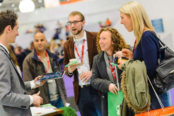 Guests at trade shows happy after using bizchargers portable cell phone chargers to keep them powered up throughout the day