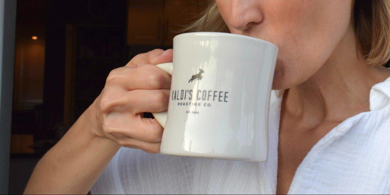 Drinking from a mug of kaldi's coffee
