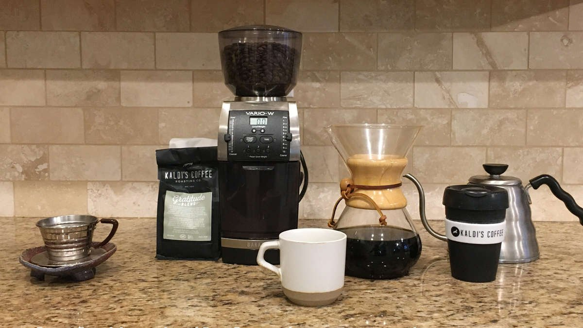 A line of home coffee brewing equipment on a counter