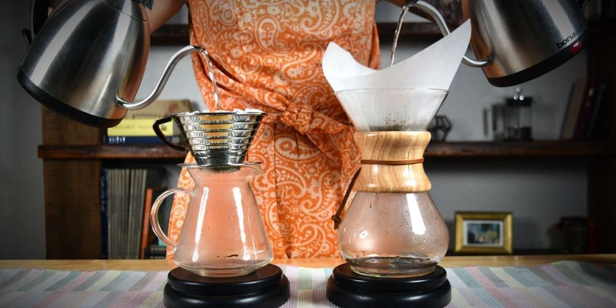 Pouring a Chemex pourover behind the bar